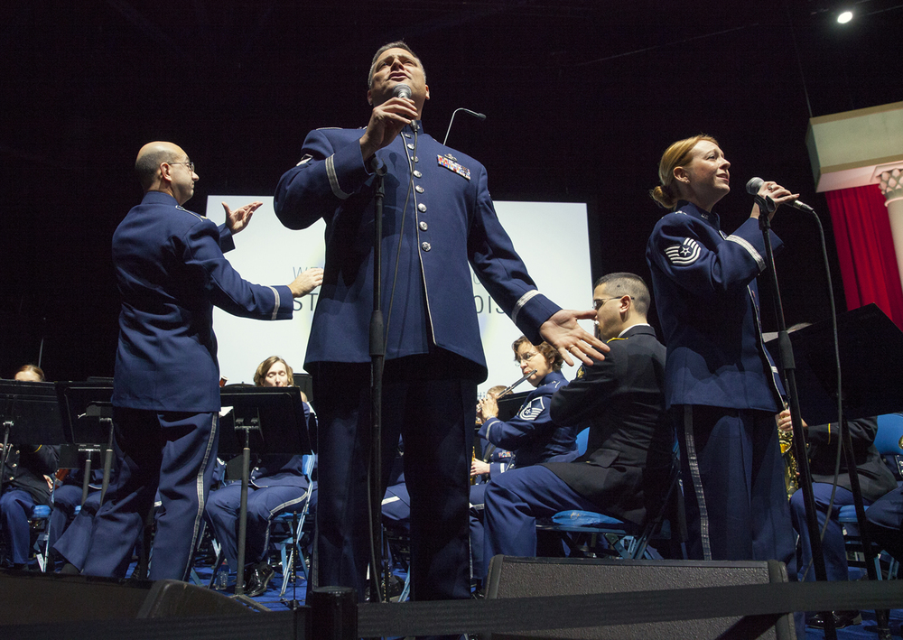 Vocalists from the combined bands of the Air National Guard Band of the Midwest and the 144th Army National Guard band perform at the inauguration of Gov. Bruce Rauner Monday, Jan. 12, 2015 at the Prairie Capital Convention Center in Springfield, Ill. Rich Saal/The State Journal-Register