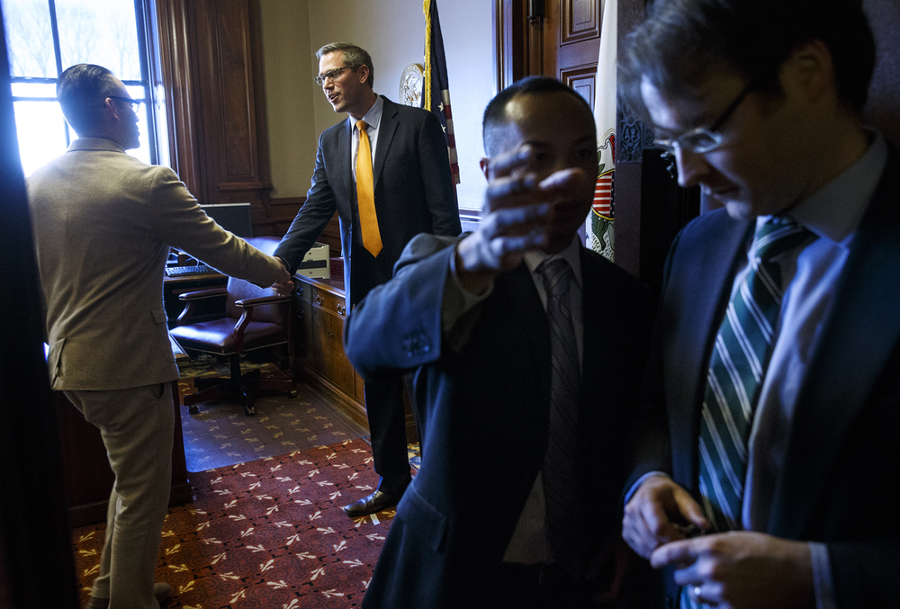 Illinois treasurer Mike Frerichs greets guests at his Capitol office during an open house Monday, Jan. 12, 2015.  Ted Schurter/The State Journal-Register