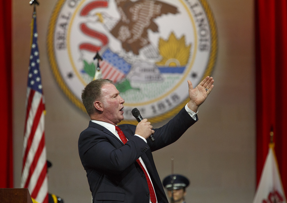 Jim Cornelison of the Chicago Blackhawks sings the National Anthem at the inauguration of Gov. Bruce Rauner Monday, Jan. 12, 2015 at the Prairie Capital Convention Center in Springfield, Ill.  Rich Saal/The State Journal-Register