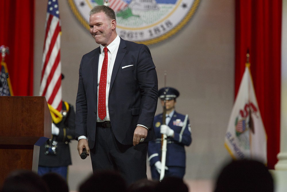 Jim Cornelison of the Chicago Blackhawks acknowledges applause after singing the National Anthem at the inauguration of Gov. Bruce Rauner Monday, Jan. 12, 2015 at the Prairie Capital Convention Center in Springfield, Ill. Rich Saal/The State Journal-Register