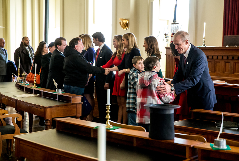 Illinois Gov. Bruce Rauner and his family greet visitors in  Representatives Hall near the desk where Abraham Lincoln sat and a replica of his hat at the Old State Capitol during an open house at the historic site, Monday, Jan. 12, 2015, in Springfield, Ill. Justin L. Fowler/The State Journal-Register