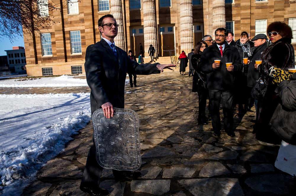 Justin Blandford, superintendent of state historic sites, offers up a bit of history on the Old State Capitol along with hot drinks as attendees wait in line outside during an open house with Illinois Gov. Bruce Rauner, Monday, Jan. 12, 2015, in Springfield, Ill. Justin L. Fowler/The State Journal-Register