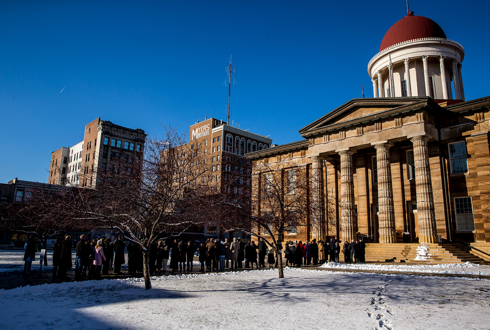 A line begins to form outside the Old State Capitol as patrons wait to meet Illinois Gov. Bruce Rauner and his family during an open house at the historic site, Monday, Jan. 12, 2015, in Springfield, Ill. Justin L. Fowler/The State Journal-Register