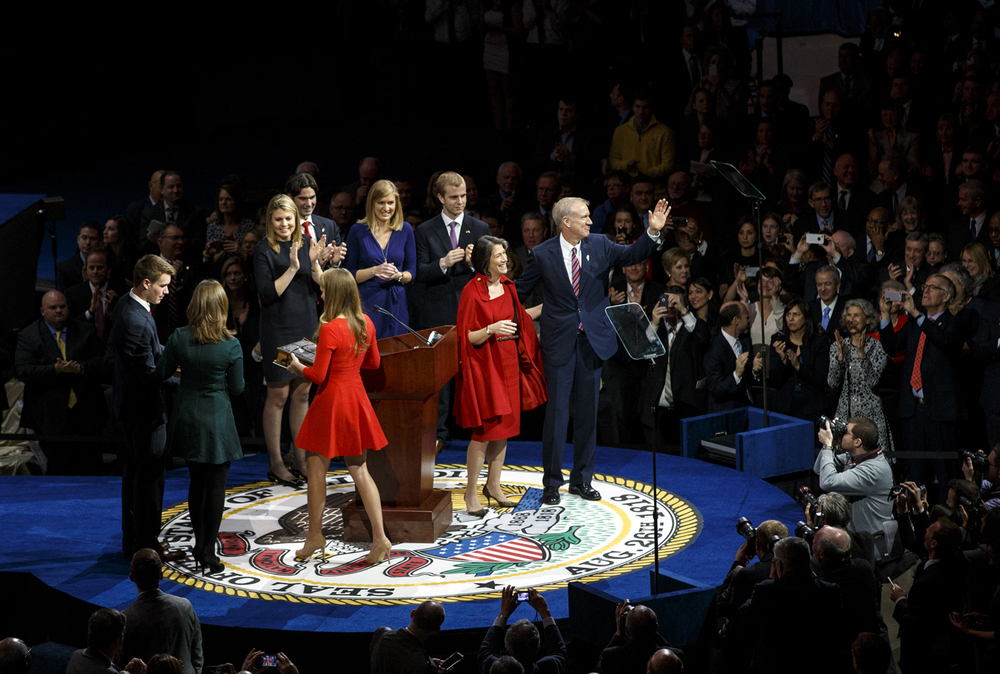 Surrounded by his family, Gov. Bruce Rauner and his wife Diana acknowledge the crowd after being sworn in during the inauguration ceremony Monday, Jan. 12, 2015. Ted Schurter/The State Journal-Register