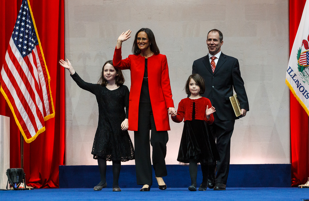 Illinois Attorney General Lisa Madigan makes her entrance with her children, Rebecca, left, and Lucy, right, along with her husband Pat Byrnes, right, during the Illinois Inaugural Ceremony at the Prairie Capital Convention Center, Monday, Jan. 12, 2015, in Springfield, Ill. Justin L. Fowler/The State Journal-Register