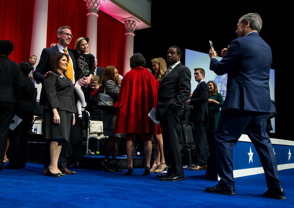 Senate President John Cullerton, right, snaps a photo of Illinois Treasure Mike Frerichs and his daughter, Ella, along with Illinois Lt. Gov. Evelyn Sanguinetti at the conclusion of the Illinois Inaugural Ceremony at the Prairie Capital Convention Center, Monday, Jan. 12, 2015, in Springfield, Ill. Justin L. Fowler/The State Journal-Register