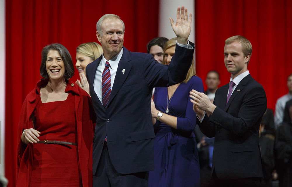 Gov. Bruce Rauner and his wife Diana wave to the crowd after Rauner was sworn in as the 42nd governor of Illinois Monday, Jan. 12, 2015 at the Prairie Capital Convention Center in Springfield, Ill. Rich Saal/The State Journal-Register