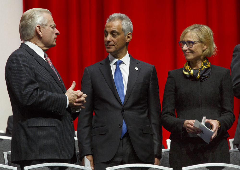 Springfield Mayor Mike Houston talks with Chicago Mayor Rahm Emanuel and his wife, Amy Rule, before the inauguration of Gov. Bruce Rauner Monday, Jan. 12, 2015 at the Prairie Capital Convention Center in Springfield, Ill. Rich Saal/The State Journal-Register