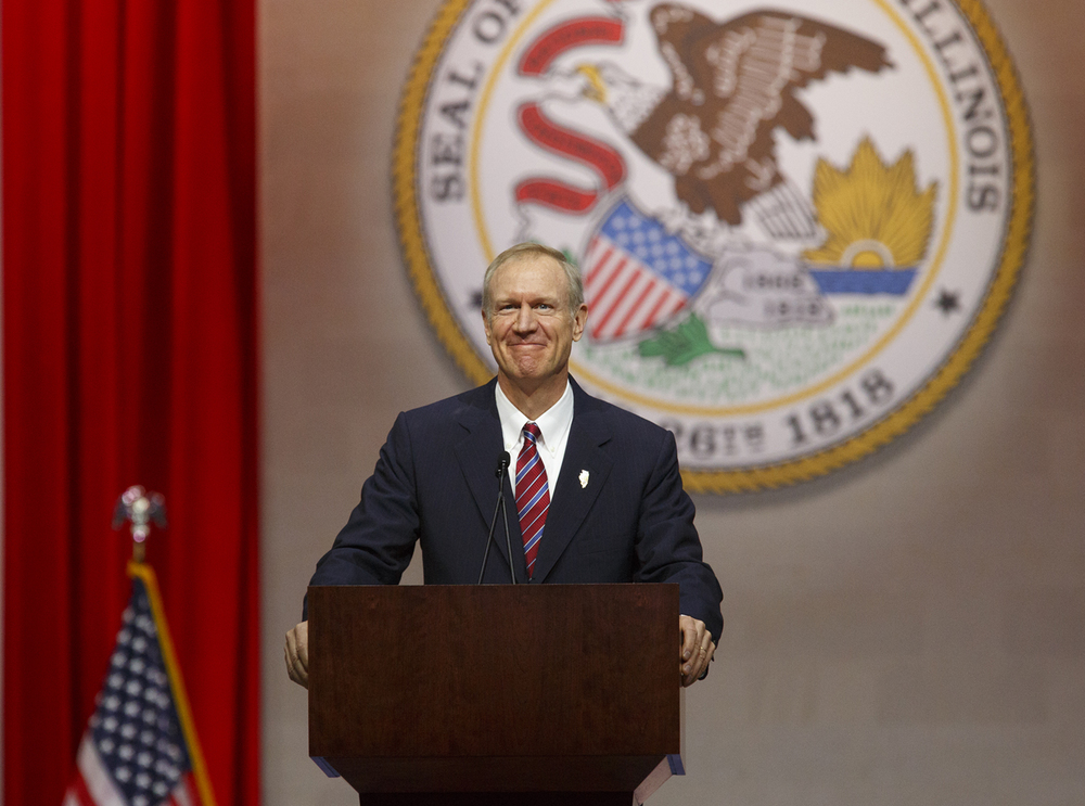 Gov. Bruce Rauner delivers his inaugural address after taking the oath as the 42nd governor of Illinois Monday, Jan. 12, 2015 at the Prairie Capital Convention Center in Springfield, Ill. Rich Saal/The State Journal-Register