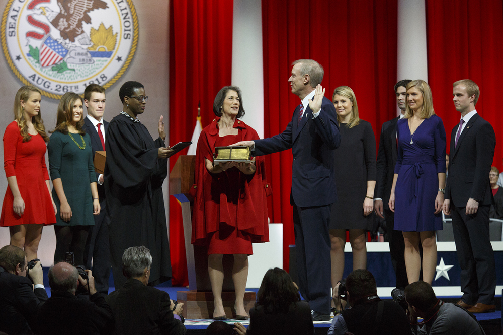 District Judge Sharon Johnson Coleman administers the oath of office to Gov. Bruce Rauner Monday, Jan. 12, 2015 at the Prairie Capital Convention Center in Springfield, Ill. Rich Saal/The State Journal-Register