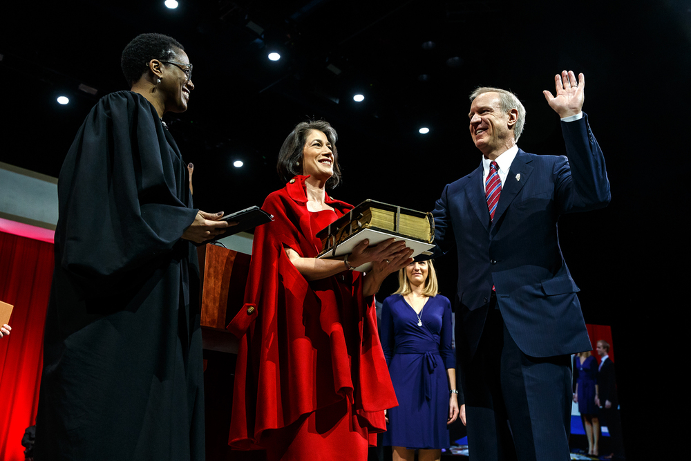 Illinois Gov.-elect Bruce Rauner takes the Oath of Office from the Honorable Sharon Johnson Coleman with his wife, Diana, holding the Bible during the Illinois inaugural Ceremony at the Prairie Capital Convention Center, Monday, Jan. 12, 2015, in Springfield, Ill. Justin L. Fowler/The State Journal-Register