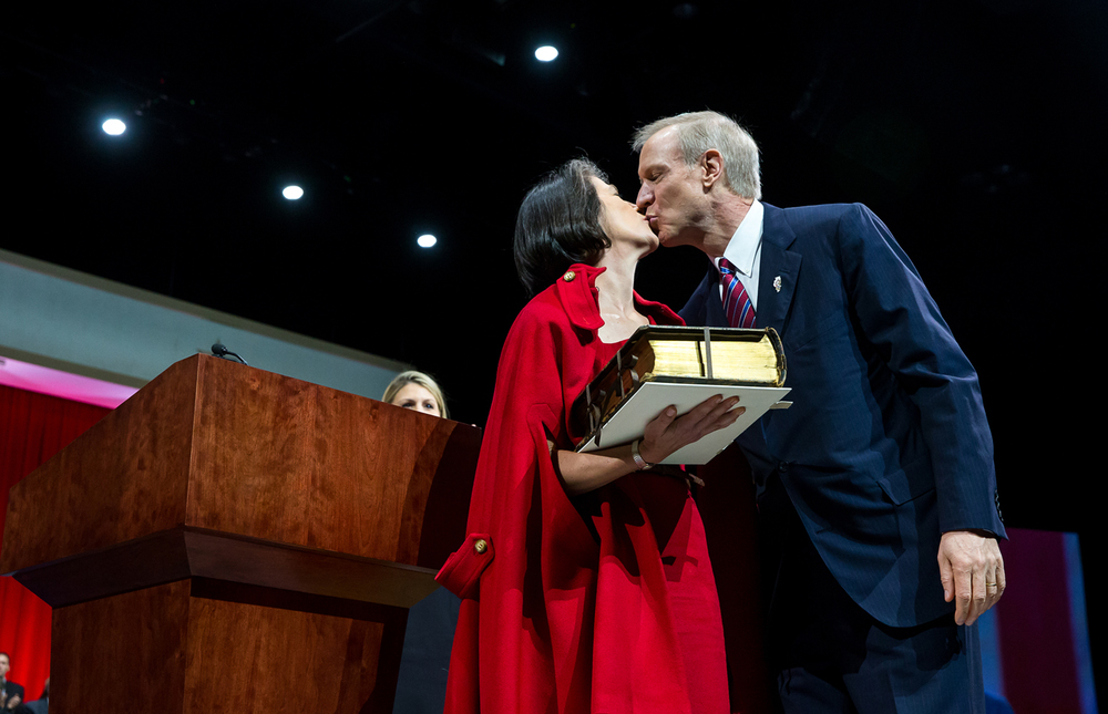 Illinois Gov. Bruce Rauner gets kiss from his wife, Diana, after taking the Oath of Office during the Illinois Inaugural Ceremony at the Prairie Capital Convention Center, Monday, Jan. 12, 2015, in Springfield, Ill. Justin L. Fowler/The State Journal-Register