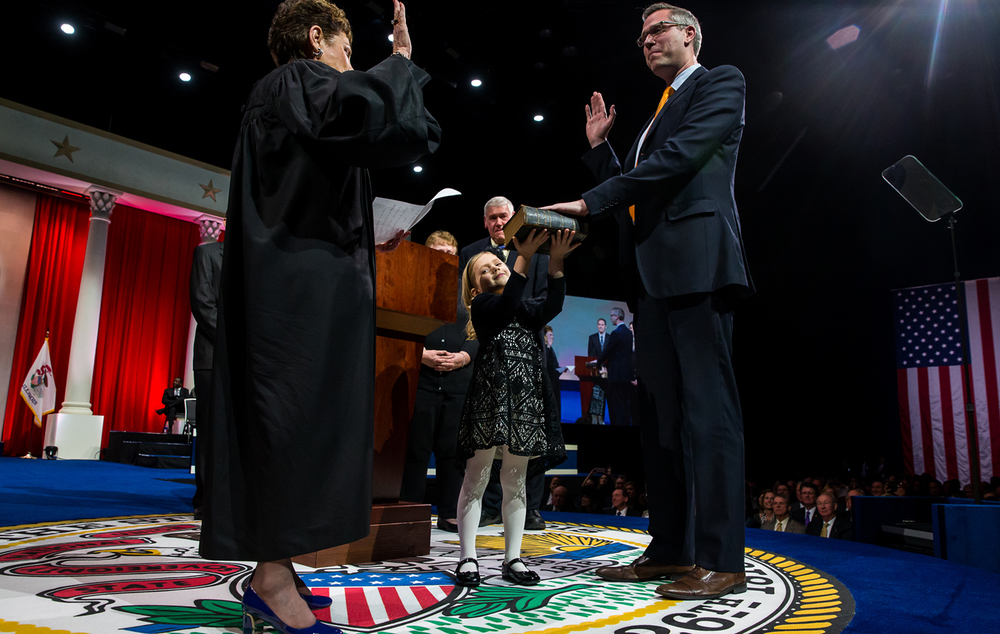 Ella Frerichs holds up the Bible as Illinois Treasurer-elect Mike Frerichs takes the oath of office from Illinois Supreme Court Chief Justice Rita B. Garman during the Illinois Inaugural Ceremony at the Prairie Capital Convention Center, Monday, Jan. 12, 2015, in Springfield, Ill. Justin L. Fowler/The State Journal-Register