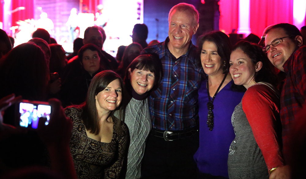 Gov. Rauner and wife Diana pose for photos with some of those 