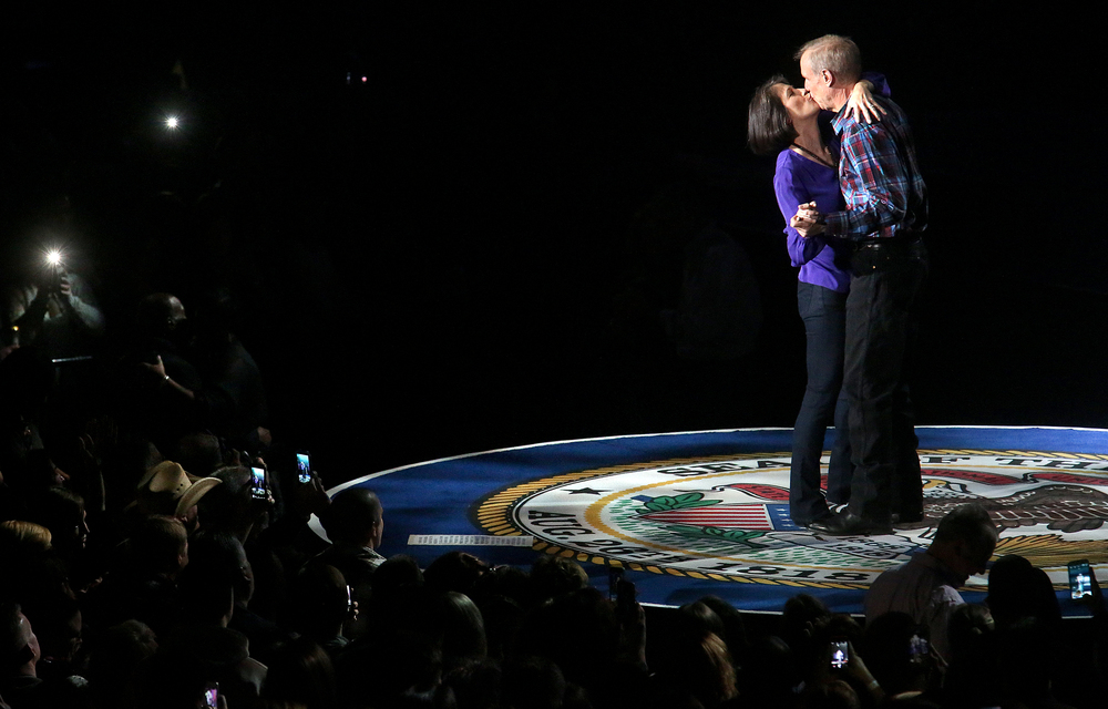 "Illinois governor Bruce Rauner and wife Diana Rauner kiss after the conclusion of the song ""You Shoulden't Kiss Me Like This"" sung by Toby Keith Monday night. Replacing the traditional inaugural ball, a concert with country singer Toby Keith as headliner took place at the Prairie Capital Convention Center in Springfield marking Bruce Rauner becoming the 42nd governor of Illinois Monday evening, Jan. 12, 2015. David Spencer/The State Journal-Register"