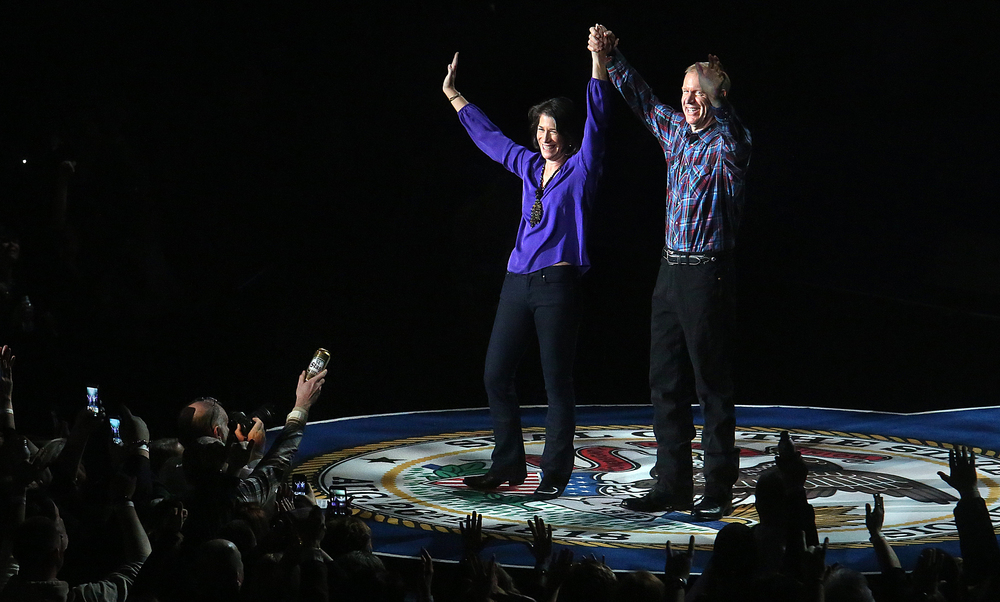 Illinois governor Bruce Rauner and wife Diana Rauner acknowledge those attending the concert Monday night after they danced together onstage while Toby Keith sang Kiss me Like This. Replacing the traditional inaugural ball, a concert with country singer Toby Keith as headliner took place at the Prairie Capital Convention Center in Springfield marking Bruce Rauner becoming the 42nd governor of Illinois Monday evening, Jan. 12, 2015. David Spencer/The State Journal-Register