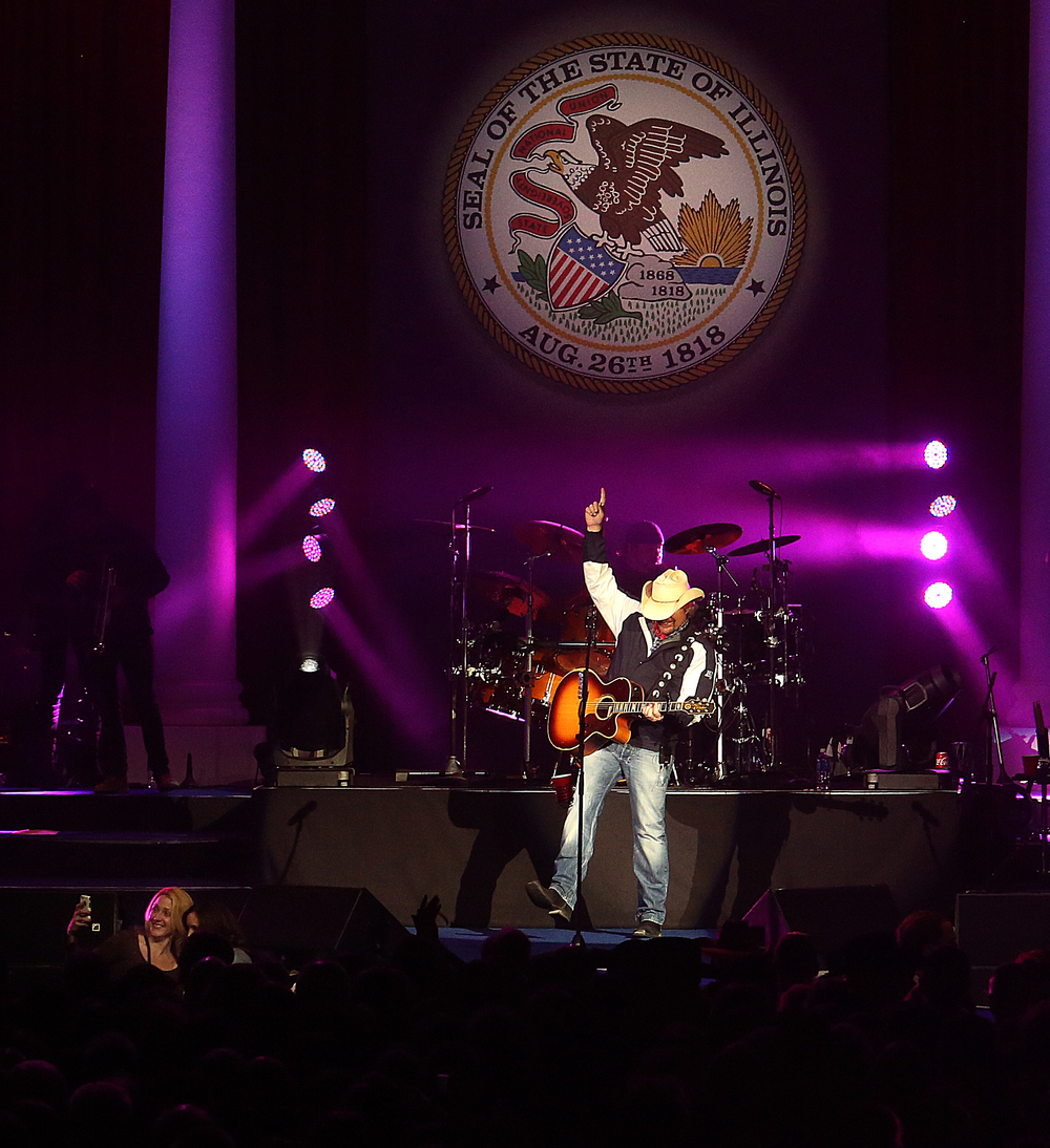 With the Illinois State seal above him, singer Toby Keith performs Monday night. Replacing the traditional inaugural ball, a concert with country singer Toby Keith as headliner took place at the Prairie Capital Convention Center in Springfield marking Bruce Rauner becoming the 42nd governor of Illinois Monday evening, Jan. 12, 2015. David Spencer/The State Journal-Register