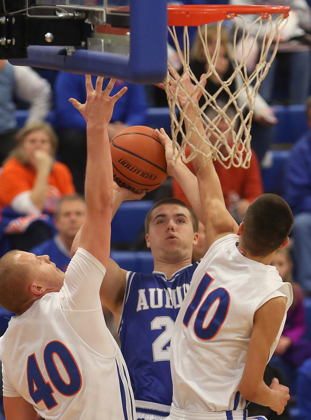 Auburn player Scott McDermand puts up two points while being defended by Riverton players Blake Suhling at left and Marc Hinkle. Auburn defeated Riverton 55-52 in boys quarterfinal action at the Sangamon County Basketball Tournament at Cass gymnasium at Lincoln Land Community College in Springfield on Tuesday evening, Jan. 13, 2015. David Spencer/The State Journal-Register