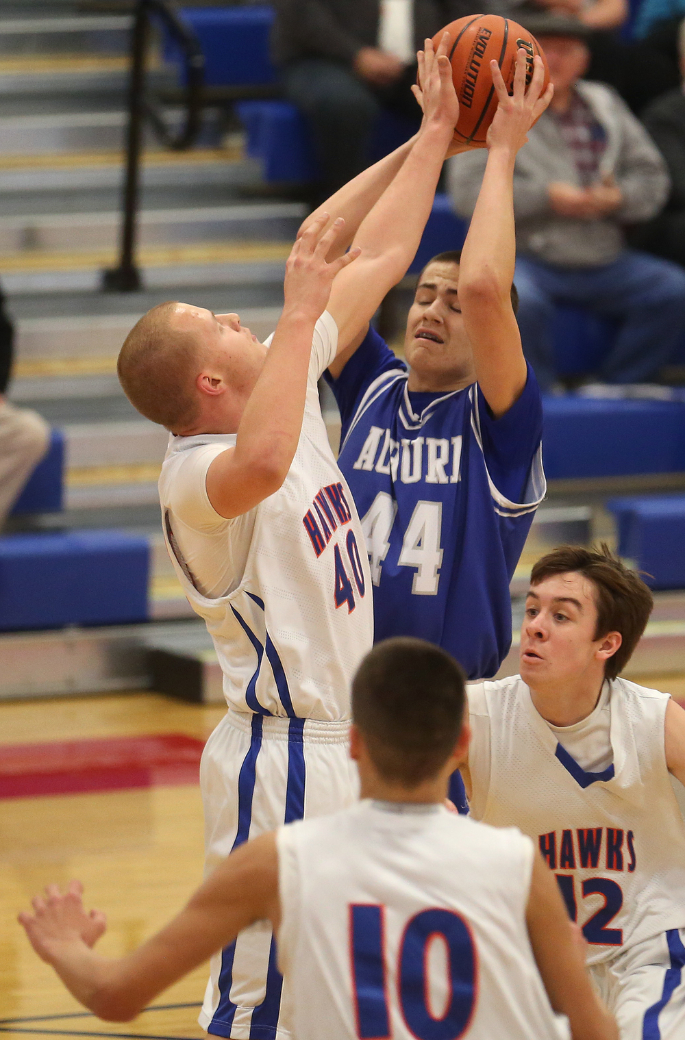 Auburn player Connor Berola fights for a rebound along with Riverton player Blake Suhling at left. Auburn defeated Riverton 55-52 in boys quarterfinal action at the Sangamon County Basketball Tournament at Cass gymnasium at Lincoln Land Community College in Springfield on Tuesday evening, Jan. 13, 2015. David Spencer/The State Journal-Register