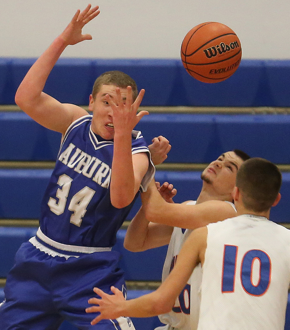 Auburn player Nate Brauer is not able to hold onto the ball under pressure from Riverton defenders including Zak Merchant at middle and Marc Hinkle. Auburn defeated Riverton 55-52 in boys quarterfinal action at the Sangamon County Basketball Tournament at Cass gymnasium at Lincoln Land Community College in Springfield on Tuesday evening, Jan. 13, 2015. David Spencer/The State Journal-Register