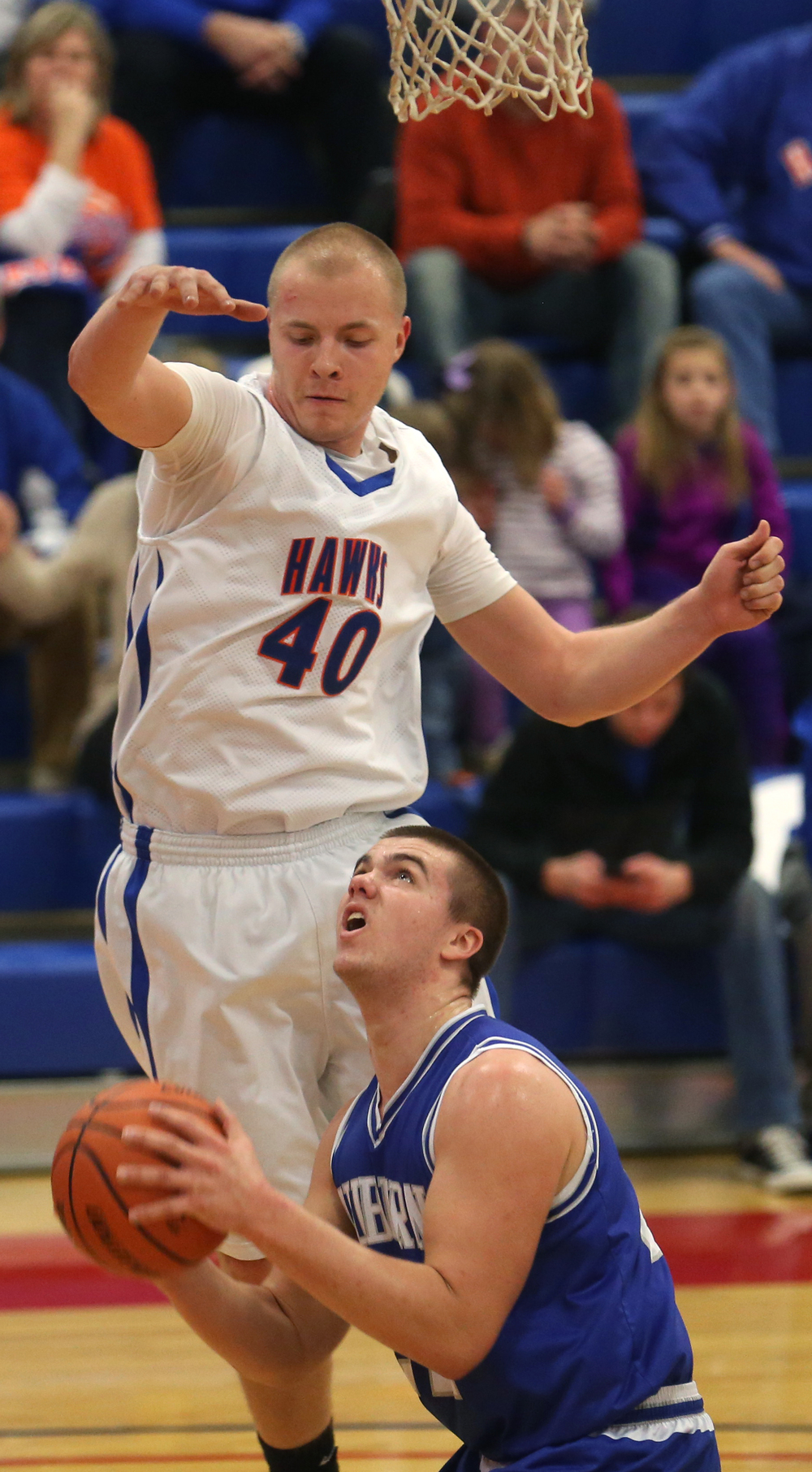 Riverton's Blake Suhling defends against Auburn player Scott McDermand. Auburn defeated Riverton 55-52 in boys quarterfinal action at the Sangamon County Basketball Tournament at Cass gymnasium at Lincoln Land Community College in Springfield on Tuesday evening, Jan. 13, 2015. David Spencer/The State Journal-Register