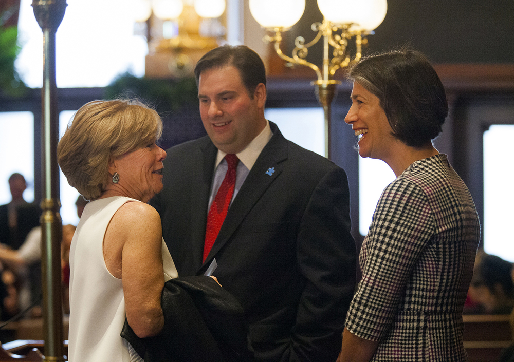 Pam Cullerton and Diana Rauner visit briefly before the at the inauguration of the Illinois Senate at the Capitol Jan. 14, 2015, Giovanni Randazzo, Senate parlimentarian and chief legal counsel to Sen. President John Cullerton, looks on. Pam Cullerton's husbnd is Sen. President John Cullerton and Diana Rauner's husband is Gov. Bruce Rauner. Rich Saal/The State Journal-Register