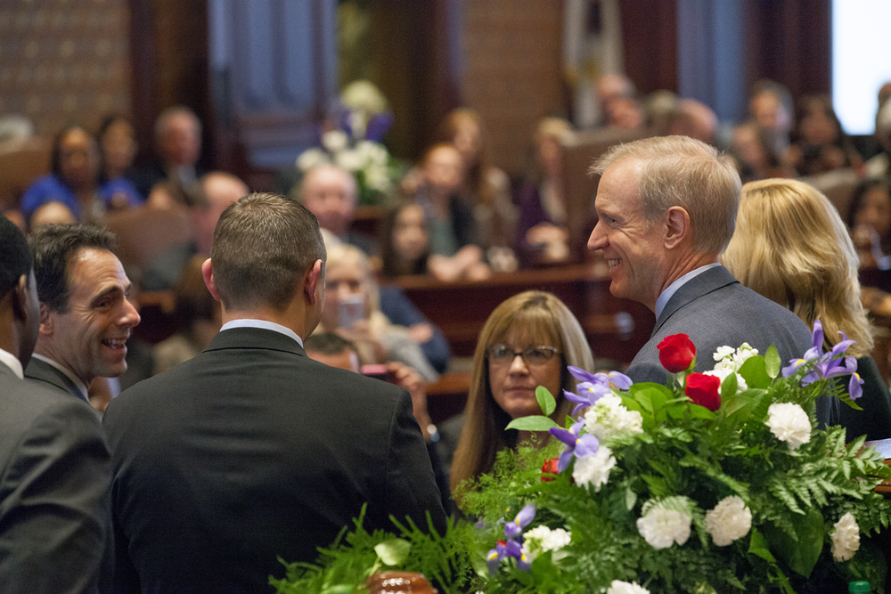 Gov. Bruce Rauner is escorted by an honorary committee of senators after the inauguration of the Illinois Senate at the Capitol Jan. 14, 2015. Rich Saal/The State Journal-Register