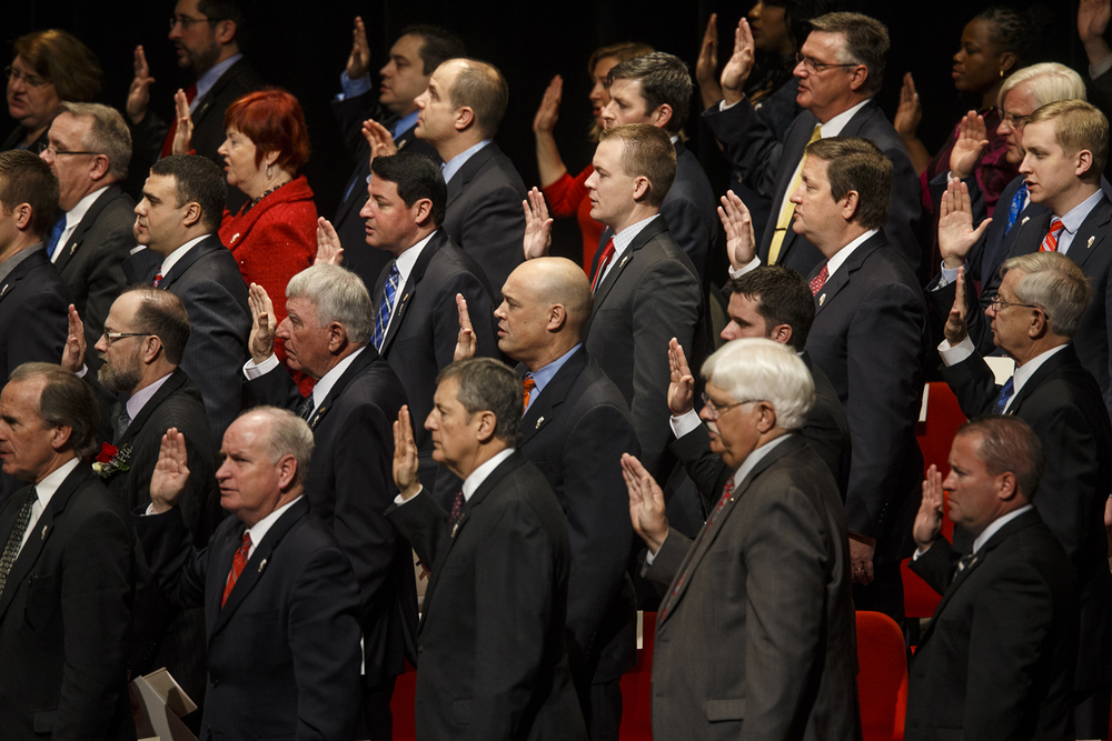 Representative C.D. Davidsmeyer, R-Jacksonville, center, and other members of the 99th General Assembly are sworn in during the Inauguration of the Illinois House of Representatives at Sangamon Auditorium Wednesday, Jan. 14, 2015. Ted Schurter/The State Journal-Register