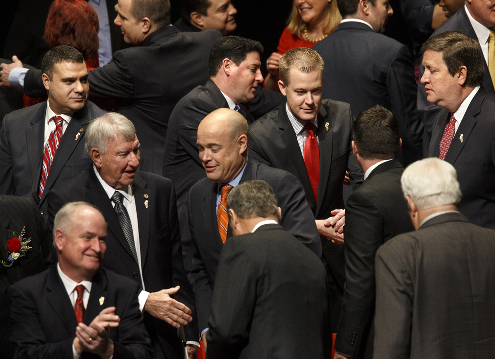 Representative C.D. Davidsmeyer, R-Jacksonville, center, greets other members of the 99th General Assembly after they were sworn in during the Inauguration of the Illinois House of Representatives at Sangamon Auditorium Wednesday, Jan. 14, 2015. Ted Schurter/The State Journal-Register