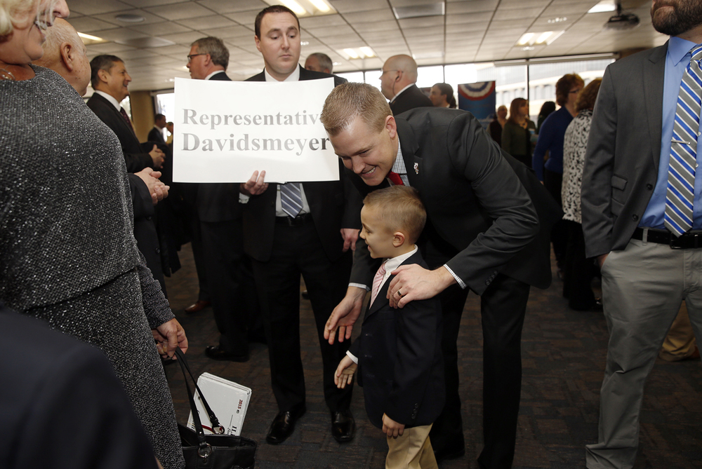 Representative C.D. Davidsmeyer, R-Jacksonville, greets his newphew Harrison Alexander before the Inauguration of the Illinois House of Representatives at Sangamon Auditorium Wednesday, Jan. 14, 2015. Ted Schurter/The State Journal-Register