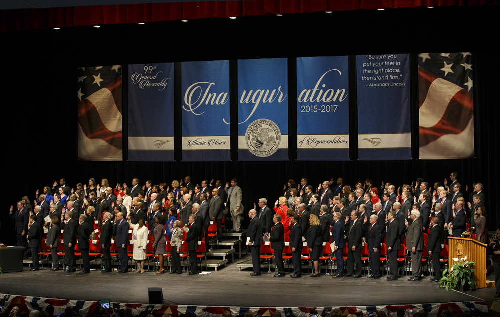 Members of the Illinois House of Representatives 99th General Assembly take the oath of office at Sangamon Auditorium Wednesday, Jan. 14, 2015. Ted Schurter/The State Journal-Register
