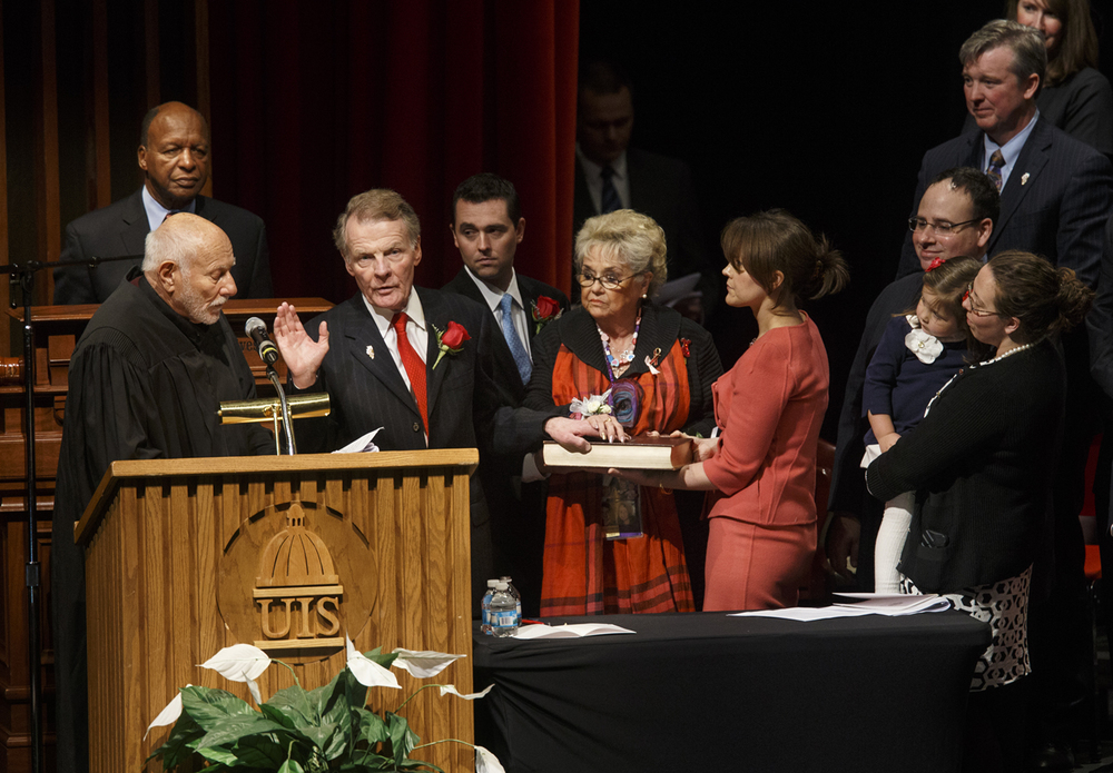 Retired Justice Alan J. Greiman delivers the oath of office to House Speaker Michael Madigan as his wife Shirley stands beside him during the inauguration of the Illinois House of Representatives Wednesday, Jan. 14, 2015. Illinois Secretary of State Jesse White is at left.  Ted Schurter/The State Journal-Register