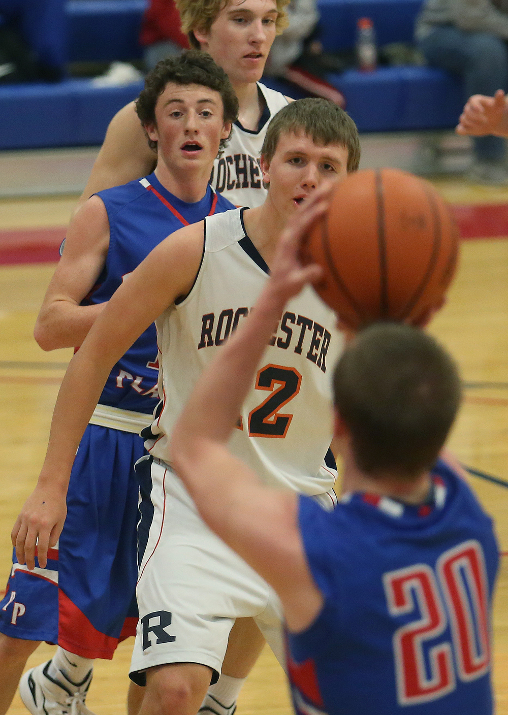 Pleasant Plains player Dylan Bee looks to pass to teammate Daulton Nibbe in a sandwich with Rochester defender Dan Zeigler. Rochester defeated Pleasant Plains 61-37 in a semifinal game at the Sangamon County Basketball Tournament at Cass gymnasium at Lincoln Land Community College in Springfield on Wednesday evening, Jan. 14, 2015. David Spencer/The State Journal-Register