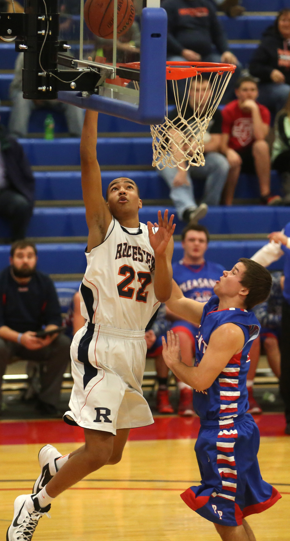 Rochester player Collin Stallworth hits a layup for two points while Plains player Jacob Cronister defends. Rochester defeated Pleasant Plains 61-37 in a semifinal game at the Sangamon County Basketball Tournament at Cass gymnasium at Lincoln Land Community College in Springfield on Wednesday evening, Jan. 14, 2015. David Spencer/The State Journal-Register