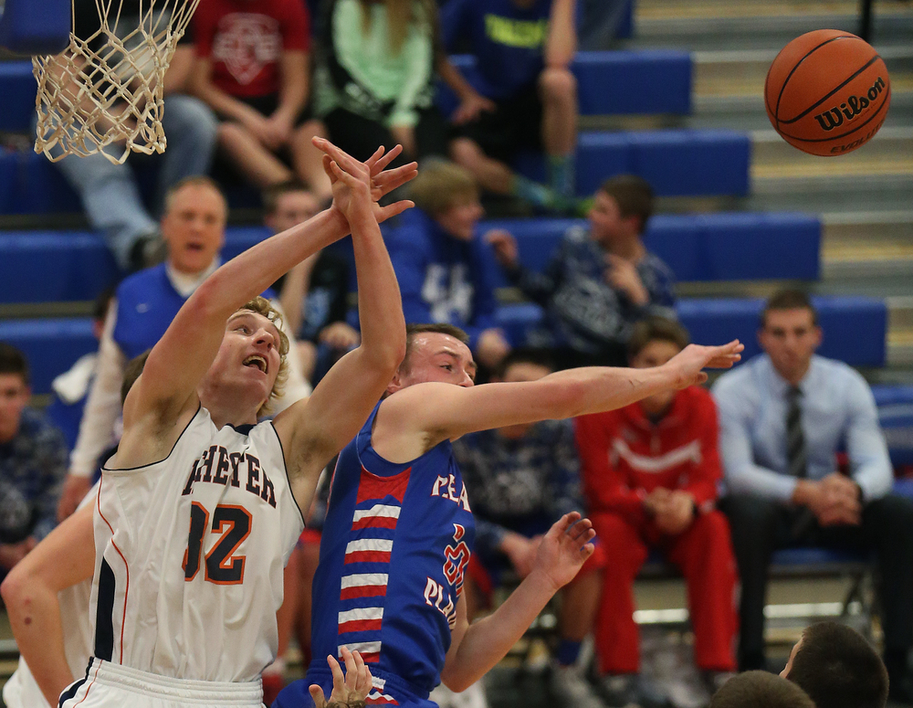 Rochester player Matt McClintock and Plains player Dylan Bee go after a rebound. Rochester defeated Pleasant Plains 61-37 in a semifinal game at the Sangamon County Basketball Tournament at Cass gymnasium at Lincoln Land Community College in Springfield on Wednesday evening, Jan. 14, 2015. David Spencer/The State Journal-Register
