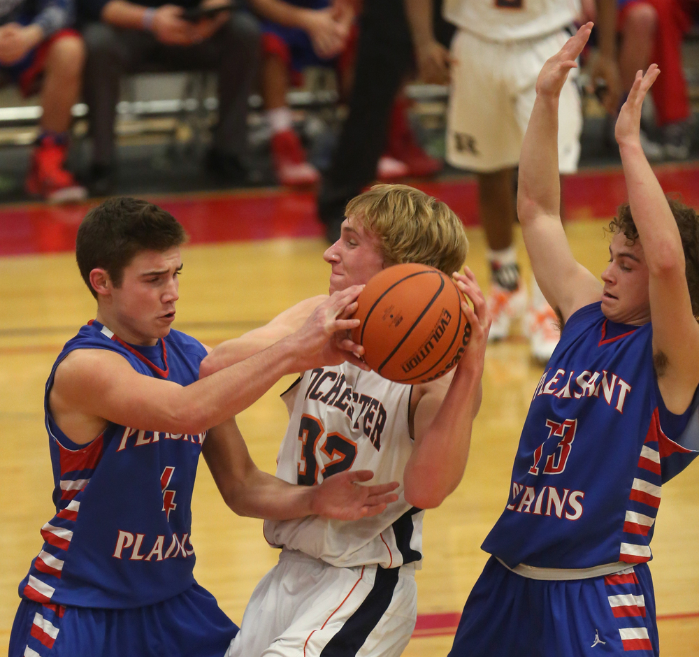 Plains player Aden Sachs at left tries to strip the ball from Rochester player Matt McClintock while Plains player Cole Greer defends at right.  Rochester defeated Pleasant Plains 61-37 in a semifinal game at the Sangamon County Basketball Tournament at Cass gymnasium at Lincoln Land Community College in Springfield on Wednesday evening, Jan. 14, 2015. David Spencer/The State Journal-Register