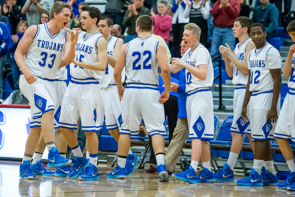 Auburn's Cooper Eaker (33) and the Trojans are fired up after defeating Williamsville to advance to the championship game during the Sangamon County Tournament at  Lincoln Land Community College's Cass Gymnasium, Thursday, Jan. 15, 2015, in Springfield, Ill. Justin L. Fowler/The State Journal-Register