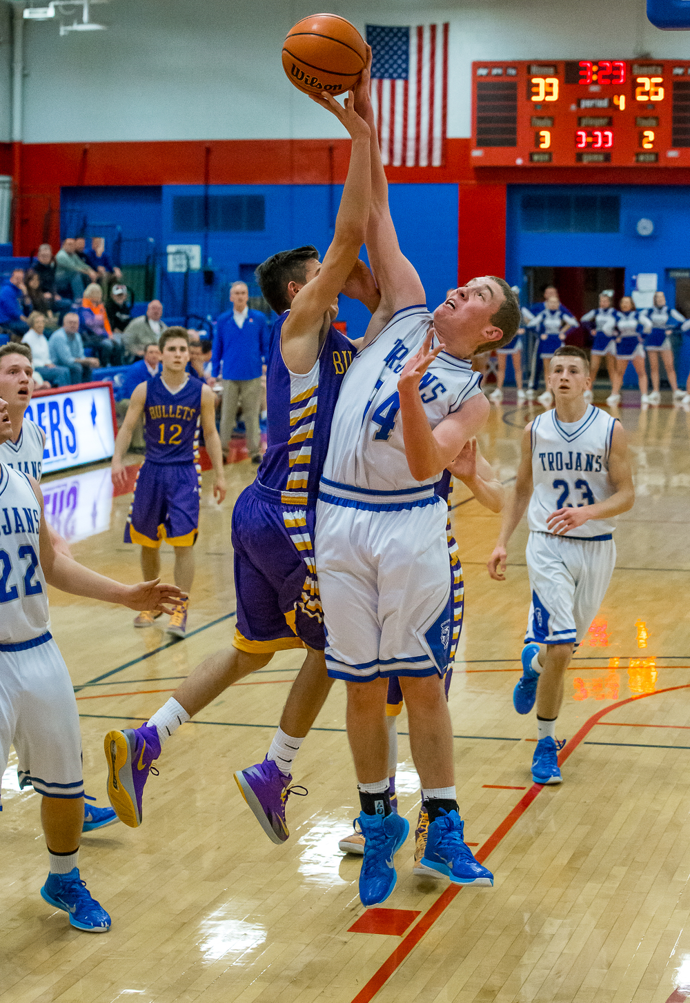 Auburn's Nate Brauer (34) gets called for a foul trying to block a shot from Williamsville's Ben Kovacevich (3) in the second half during the Sangamon County Tournament at  Lincoln Land Community College's Cass Gymnasium, Thursday, Jan. 15, 2015, in Springfield, Ill. Justin L. Fowler/The State Journal-Register