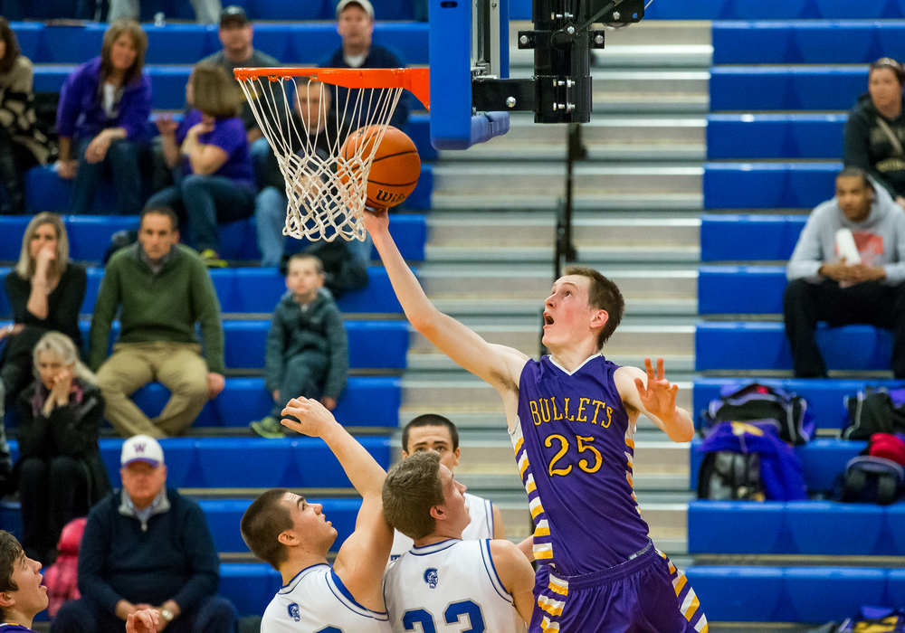 Williamsville's Harrison Creswell (25) goes baseline for a layup against Auburn in the second half during the Sangamon County Tournament at  Lincoln Land Community College's Cass Gymnasium, Thursday, Jan. 15, 2015, in Springfield, Ill. Justin L. Fowler/The State Journal-Register