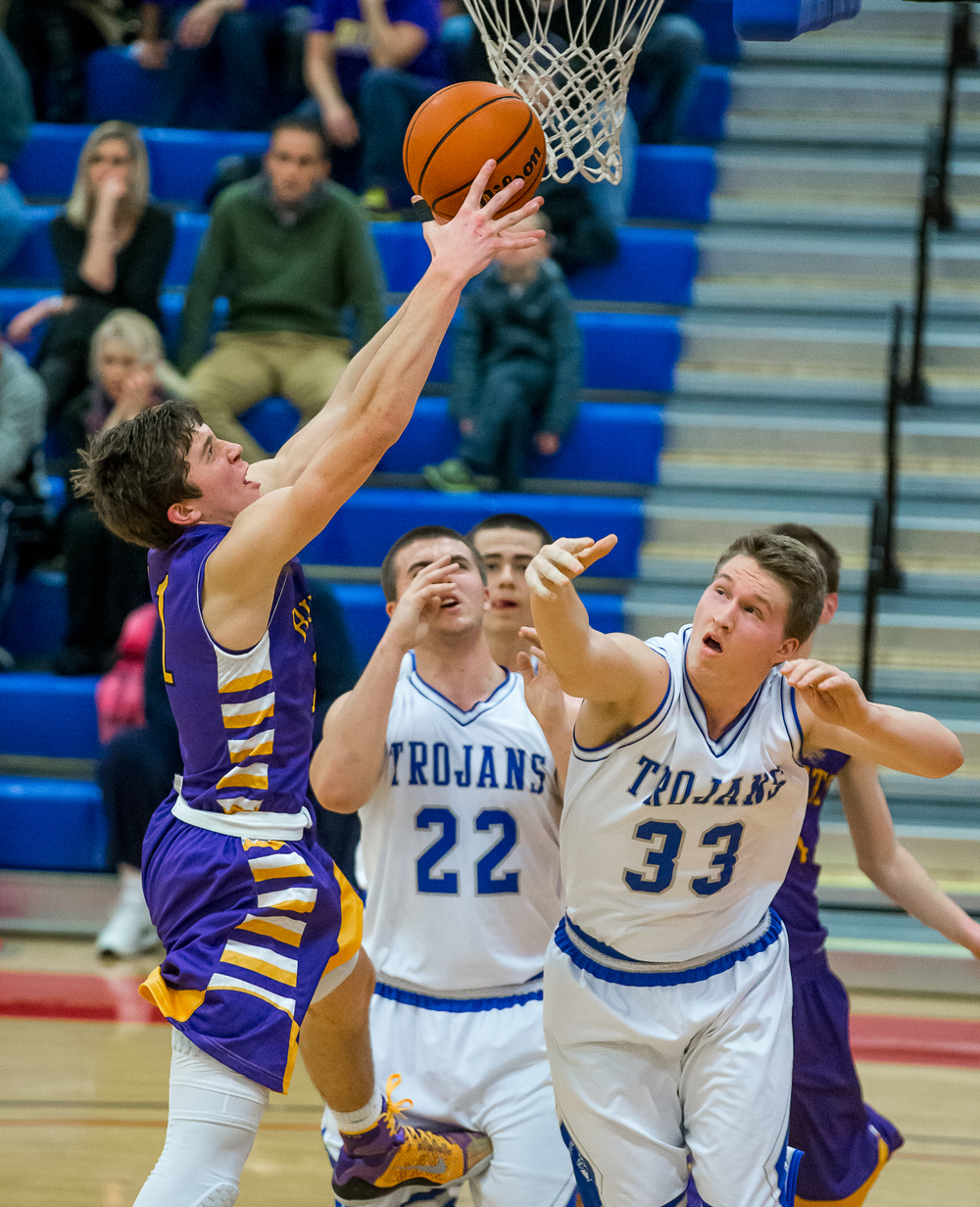 Williamsville's Jack Zibutis (11) goes for a rebound against Auburn's Cooper Eaker (33) underneath the basket in the second half during the Sangamon County Tournament at  Lincoln Land Community College's Cass Gymnasium, Thursday, Jan. 15, 2015, in Springfield, Ill. Justin L. Fowler/The State Journal-Register