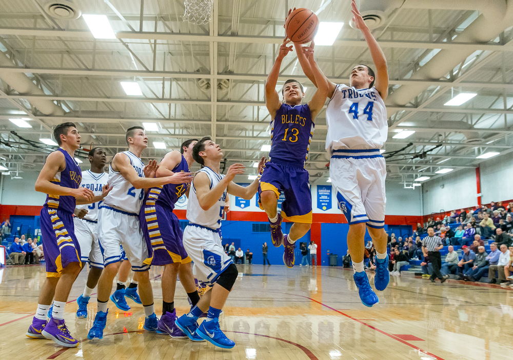 Auburn's Connor Berola (44) and Williamsville's Zack Dellert (13) go for a rebound in the first half during the Sangamon County Tournament at  Lincoln Land Community College's Cass Gymnasium, Thursday, Jan. 15, 2015, in Springfield, Ill. Justin L. Fowler/The State Journal-Register