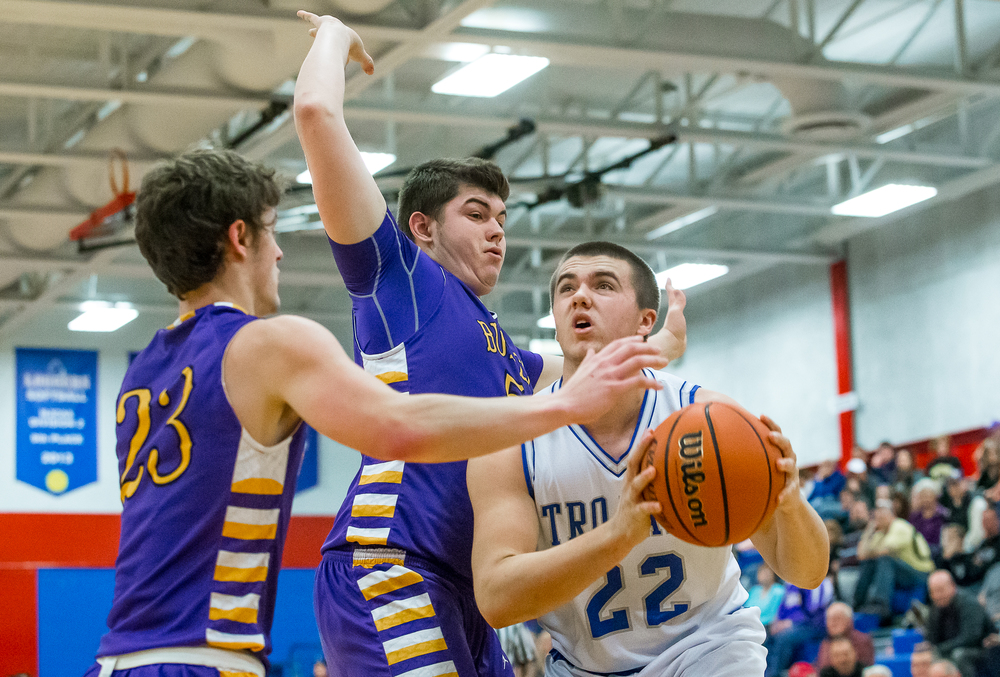 Auburn's Scott McDermand (22) powers into the basket against Williamsville's Mitch Whitley (51) in the first half during the Sangamon County Tournament at  Lincoln Land Community College's Cass Gymnasium, Thursday, Jan. 15, 2015, in Springfield, Ill. Justin L. Fowler/The State Journal-Register