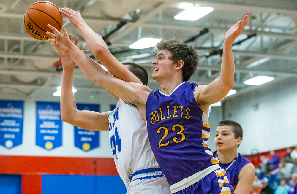 Williamsville's Drew Keenan (23) goes for a rebound against Auburn's Connor Berola (44) in the first half during the Sangamon County Tournament at  Lincoln Land Community College's Cass Gymnasium, Thursday, Jan. 15, 2015, in Springfield, Ill. Justin L. Fowler/The State Journal-Register