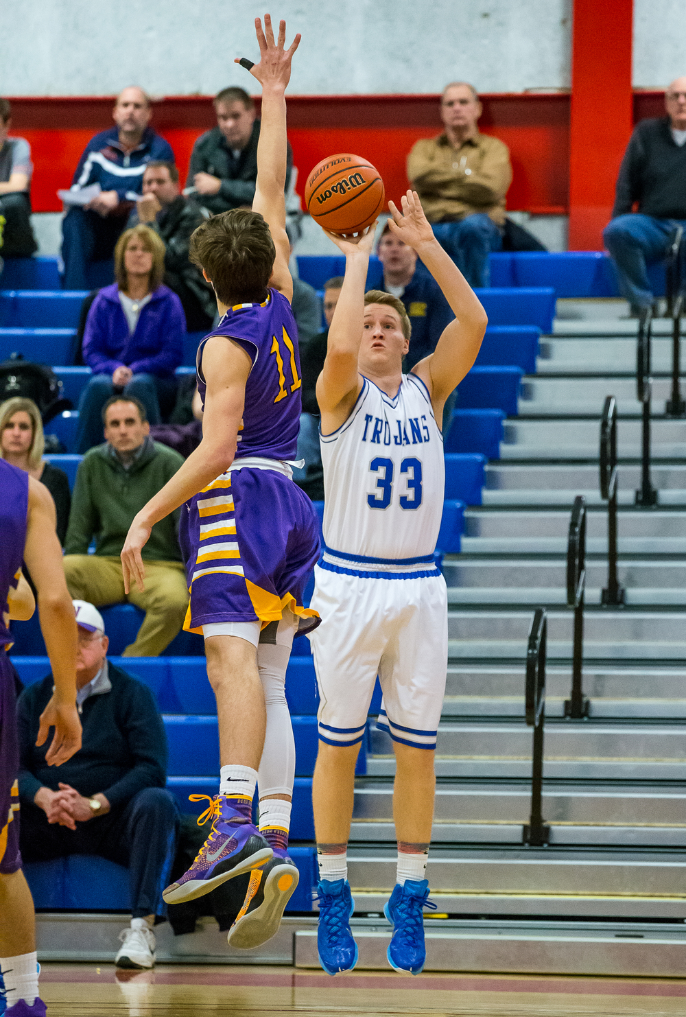 Auburn's Cooper Eaker (33) fires off a shot in front of Williamsville's Jack Zibutis (11) in the first half during the Sangamon County Tournament at  Lincoln Land Community College's Cass Gymnasium, Thursday, Jan. 15, 2015, in Springfield, Ill. Justin L. Fowler/The State Journal-Register