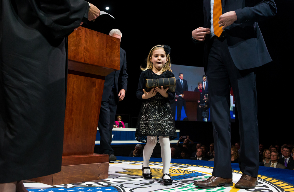 Ella Frerichs carries in the Bible for Illinois Treasurer-elect Mike Frerichs to take the oath of office during the Illinois Inaugural Ceremony at the Prairie Capital Convention Center, Monday, Jan. 12, 2015, in Springfield, Ill. Justin L. Fowler/The State Journal-Register