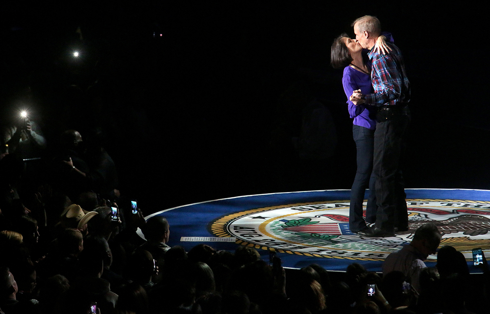 Illinois governor Bruce Rauner and wife Diana Rauner kiss after the conclusion of the song Kiss me Like This sung by Toby Keith Monday night. Replacing the traditional inaugural ball, a concert with country singer Toby Keith as headliner took place at the Prairie Capital Convention Center in Springfield marking Bruce Rauner becoming the 42nd governor of Illinois Monday evening, Jan. 12, 2015. David Spencer/The State Journal-Register