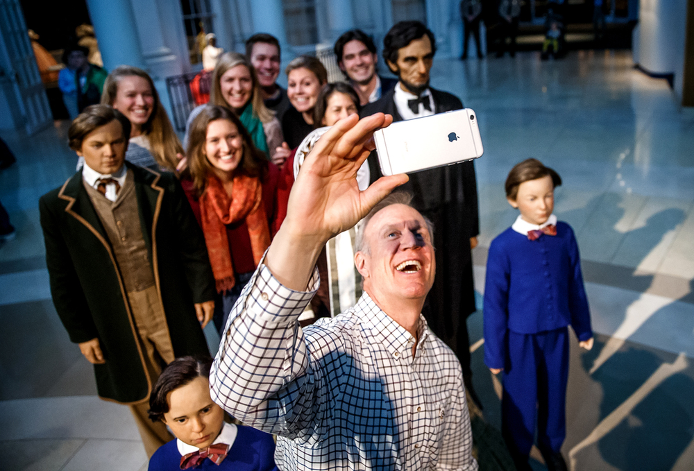 Illinois Gov.-elect Bruce Rauner takes a selfie with his family along with the figures of the Lincoln family inside the plaza of the Abraham Lincoln Presidential Museum, Sunday, Jan. 11, 2015, in Springfield, Ill. Justin L. Fowler/The State Journal-Register