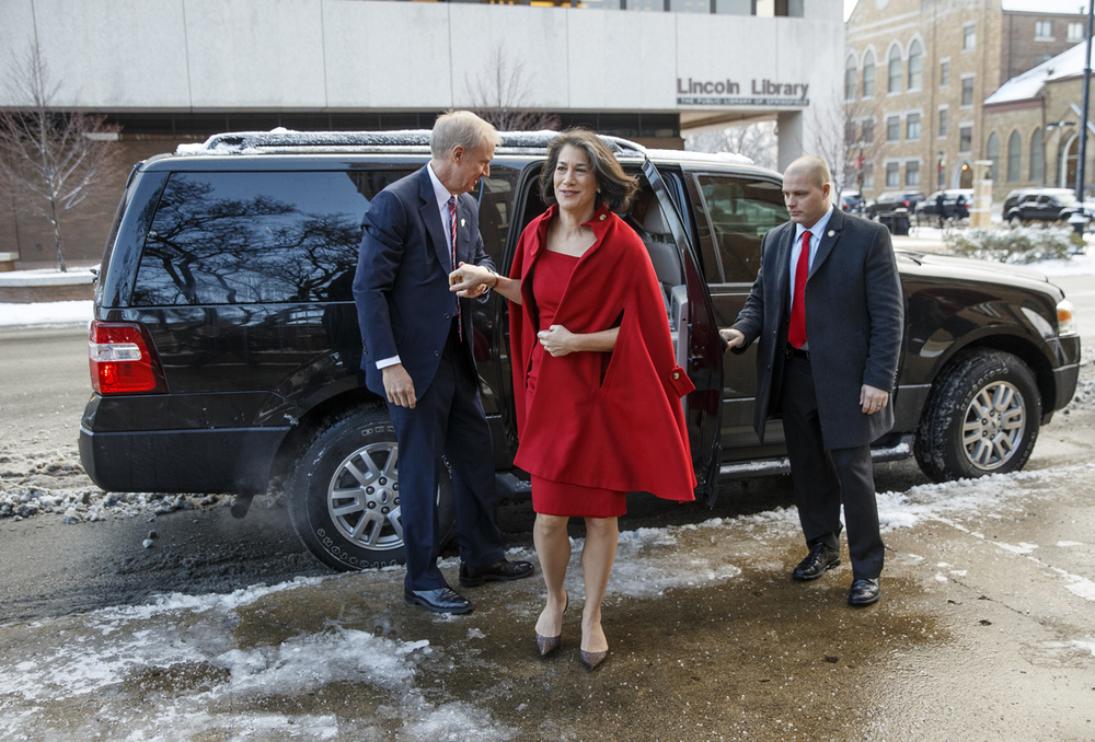 Gov.-elect Bruce Rauner arrives with his wife, Diana for the interfaith prayer service for constitutional officers at First Presbyterian Church Monday, Jan. 12, 2015.  Ted Schurter/The State Journal-Register