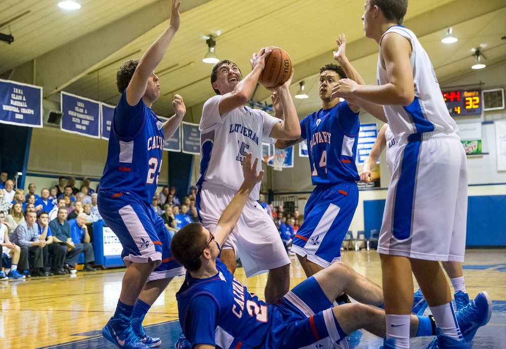 Lutheran's Adam Forestier (15) battles underneath the basket against a trio of Calvary defenders during the second half at Lutheran High School, Friday, Jan. 16, 2015, in Springfield, Ill. Justin L. Fowler/The State Journal-Register