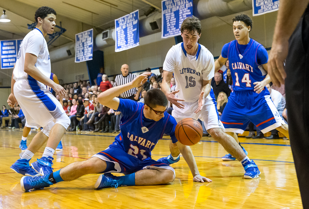 Lutheran's Adam Forestier (15) goes for a loose ball against Calvary's Neil Ferris (21) during the first half at Lutheran High School, Friday, Jan. 16, 2015, in Springfield, Ill. Justin L. Fowler/The State Journal-Register